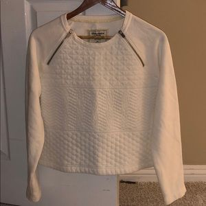 White sweater with zipper accents